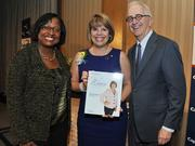 Honoree Lidia Soto-Harmonaccepts award from Colleen Taylor of Capital One and Alex Orfinger of the Washington Business Journal at the 2012 Women Who Mean Business event.