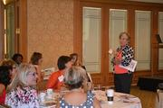 Susan Peterson tells guests at theWomen Who Mean Business breakfasthow to handle crises in the media.