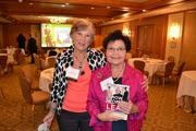"""Featured speaker Susan Peterson, left, founder and chair of The Communication Center, with Sharon Hadary, co-author of """"How Women Lead,"""" which was given to guests at the breakfast courtesy of the event sponsor, Capital One Bank."""