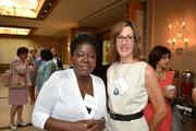 Aoko Midiwo-Odembo, left, from Legacy Books International, and Mary Abbajay from CareerStone Group at the Women Who Mean Business breakfast.