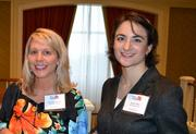 Christine Cessna, left, from Ultimate Staffing with Sarah Hiller from John Snow Inc.