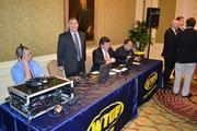 WTOP broadcast live from the morning event, with anchor Mike Moss, center, emceeing the awards.