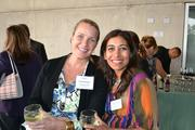Frederique Irwin, left, of Her Corner LLC and Anjali Varma of Kidville Bethesdaat Cadre's Event of Business Awesome.