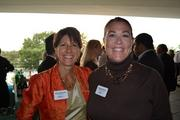 Kathy Albarado, left, president and CEO of Helio HR, with Reggie Kouba of RMK Productionsat Cadre's Event of Business Awesome.