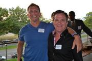 Jay Greenstein, left, of Sport and Spine Companies, with Matt Curry, president and CEO of Curry's Auto Service Inc.at Cadre's Event of Business Awesome.