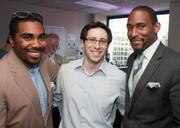 Kendrick Jackson, from left, Brandon Pollak and Brandon Andrews at Gryphn's Cake & Scotch Party at the firm's new headquarters and first office.