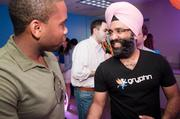 Gryphn Co-founder and CEO Navroop Mitter, right, celebrating the new headquarters of the mobile security company.