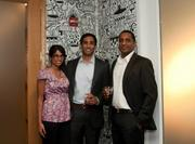 Pam Dhaliwal, from left, AJ Dhaliwal and Jerry Joseph at Gryphn's Cake & Scotch Party at 1707 L St. NW, the mobile security company's new headquarters.