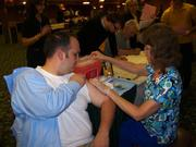 A Corporate Network Services employee gets a flu shot at the company's health fair.