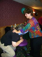 A Corporate Network Services employee gets a massage at the company's health fair.