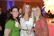 Bonnie Flippin, from left, from WorkSpaces LLC, Pam Zandy from Monument Realty LLC, and Bethany Allen from Monument Realty LLC at the CREW D.C. Awards.