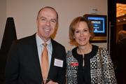 Adrian Chapman, left, from Washington Gas, with Allison Wakenight at Cardinal Bank's economic conference.
