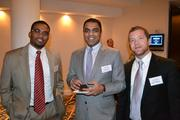 Research Assistants from George Mason University, Maurice Champagne, from left, Lokesh Dani, and Ryan Price at Cardinal Bank's economic conference.