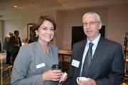 Cheryl Beebe from Cardinal Bank with Rick Hurwitt from William A. Hazel, Inc. at Cardinal Bank's economic conference.