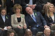 Former Rep. Gabrielle Giffords, second from left, and husband Mark Kelly, retired space shuttle commander, listen to President Barack Obama's State of the Union address.