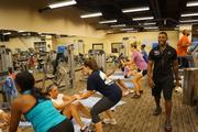 Staff at Gaylord National Resort & Convention Center participate in STAR Boot Camp with personal trainer Walter Lewis.
