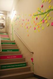 Decorated stairwells encourage Gensler employees to skip the elevator.