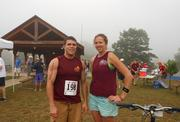 Gentle Giant Moving Co. Inc. employees Andrew Rozzi and Stefanie Kozuszek at the XTERRA EX2 Off-Road Triathlon and Duathlon at Rocky Gap State Park in Flintstone.