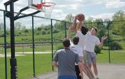 Motley Fool employees gather weekly to play basketball on nearby rented courts.