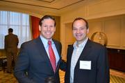 Greg Foscato, left, of the Washington Nationals Baseball Club with Greg Stavrou of Rand Construction Corp.  at the Multifamily Development Symposium.