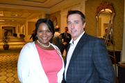 Qiana Randall, left, from Washington Gas with Scott Coulter from Architectural Ceramics at the Multifamily Development Symposium.