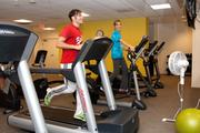 Sam and Gail from Neustar Inc. work out on their lunch break at the company's on-site gym.
