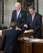 President Barack Obama greets House Speaker John Boehner, R-Ohio, right, and Vice President Joe Biden.