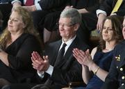 Apple Inc. CEO Tim Cook applauds during President Barack Obama's State of the Union address.
