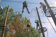 The ropes course at George Mason University provide challenges both physical and psychological for staff at Pharmaceutical Research and Manufacturers of America.