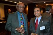 Jim Dyke of McGuireWoods, left, and Dinesh Sharma of Washington Business Group at the pre-event dinner for the 2013 Minority Business Leader Awards.