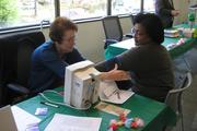 Reston Association employees can have their blood pressure checked at a health fair.