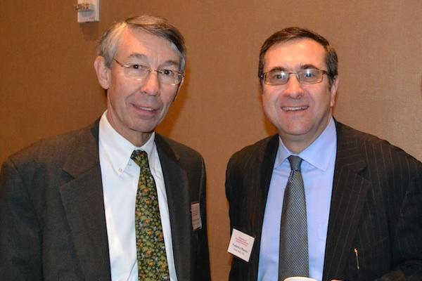 Stephen Fuller, director of the Center for Regional Analysis at George Mason University's School of Public Policy, with Federico Manno from Fulton Bank, N.A. at Cardinal Bank's economic conference.
