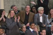 Musician Ted Nugent, center, listens to President Barack Obama's State of the Union address.