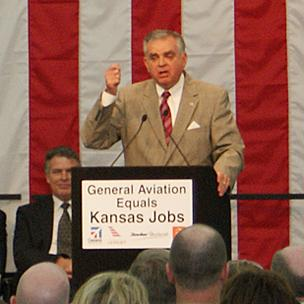 U.S. Department of Transportation Secretary Ray LaHood praises the general aviation industry at a rally Monday morning.