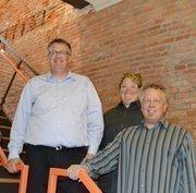 Howerton + White partnersBryan Malone, Nicole Howerton and Ken White.