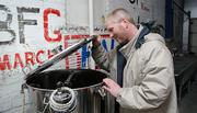 Rick Goehring, Walnut River's head brewer, shows one of the tanks used in the beer-brewing process.