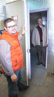 B.J. Hunt, left, and Rick Goehring show the cold-storage room they built inside their El Dorado building. It will store the kegs once they get licensed to begin producing beer. The two have done most of the construction work in the building themselves, consuming many nights and weekends.