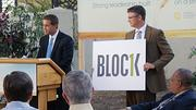 Jason Gregory of the Wichita Downtown Development Corp. holds a logo for Block 1, a new branding campaign for the block  that includes the Ambassador Hotel and is seeing major change.
