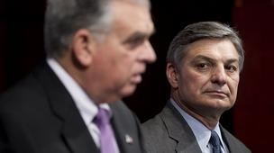 Ray Conner, president and chief executive officer of Boeing Commercial Airplanes, right, listens as Ray LaHood, U.S. secretary of transportation, speaks during a news conference Friday about the 787 review.