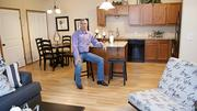 Mike Brand, a partner in Bennington Place, shows the spacious kitchen anddining area inside a model unit.