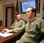 Col. Ricky Rupp, left, and Lt. Col. Mike Moeding talk about the different elements that comprise McConnell AFB.