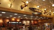 The check-out area includes a wall display reflecting Cabela's commitment to conservation and community.