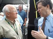 Kansas Gov. Sam Brownback speaks with Cabela's President and CEO Tommy Millner at the grand opening of the Wichita store.