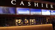 Kansas scenes are evident throughout the new casino, including in this muralby Phil Epp over the cashier's cage.
