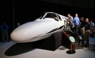 Employee and customers explore a mockup of the Citation M2 at Cessna's announcement event Monday.