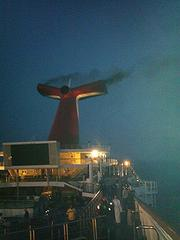 Smoke emerges from the Carnival Triumph stacks during the engine fire on Sunday morning.