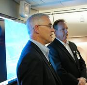 George Maffeo of Boeing, left, and Terry George of Spirit AeroSystems discuss the 787 during a tour of the aircraft.