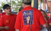 """Machinists at the rally wore T-shirts declaring, """"Lightning can STRIKE twice,"""" suggesting the possibility of a repeat performance of the union's strike in 2008 against what was then Raytheon Aircraft Co."""