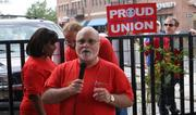 Steve Rooney, president of the Machinists union's District 70, speaks at the rally of Hawker Beechcraft Corp. workers in Old Town on Friday.