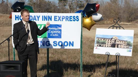 Aaron Johnson, regional operations manager for KAJ Management of Mitchell, S.D., speaks Monday about the company's planned new Holiday Inn Express & Suites hotel, work on which is about to start near the northeast corner of North Greenwich Road and E. 21st Street.